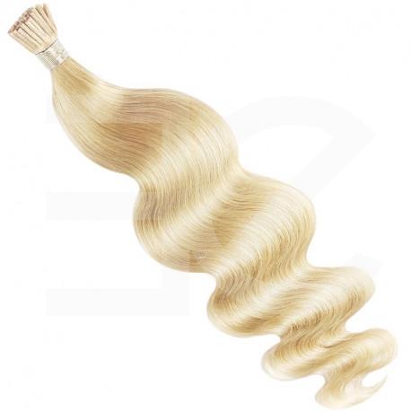 Extensions à froid blond clair cheveux bouclés 50 cm