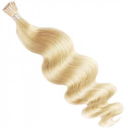 Extensions à froid blond clair cheveux bouclés 63 cm