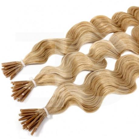Extensions à froid blondes cheveux frisés 50 cm